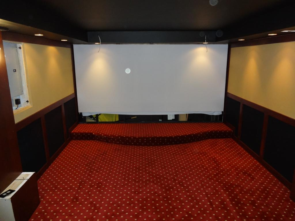 image of Spandex wide projector screen in a movie theater