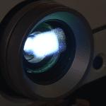 projector lense illuminating light with dust